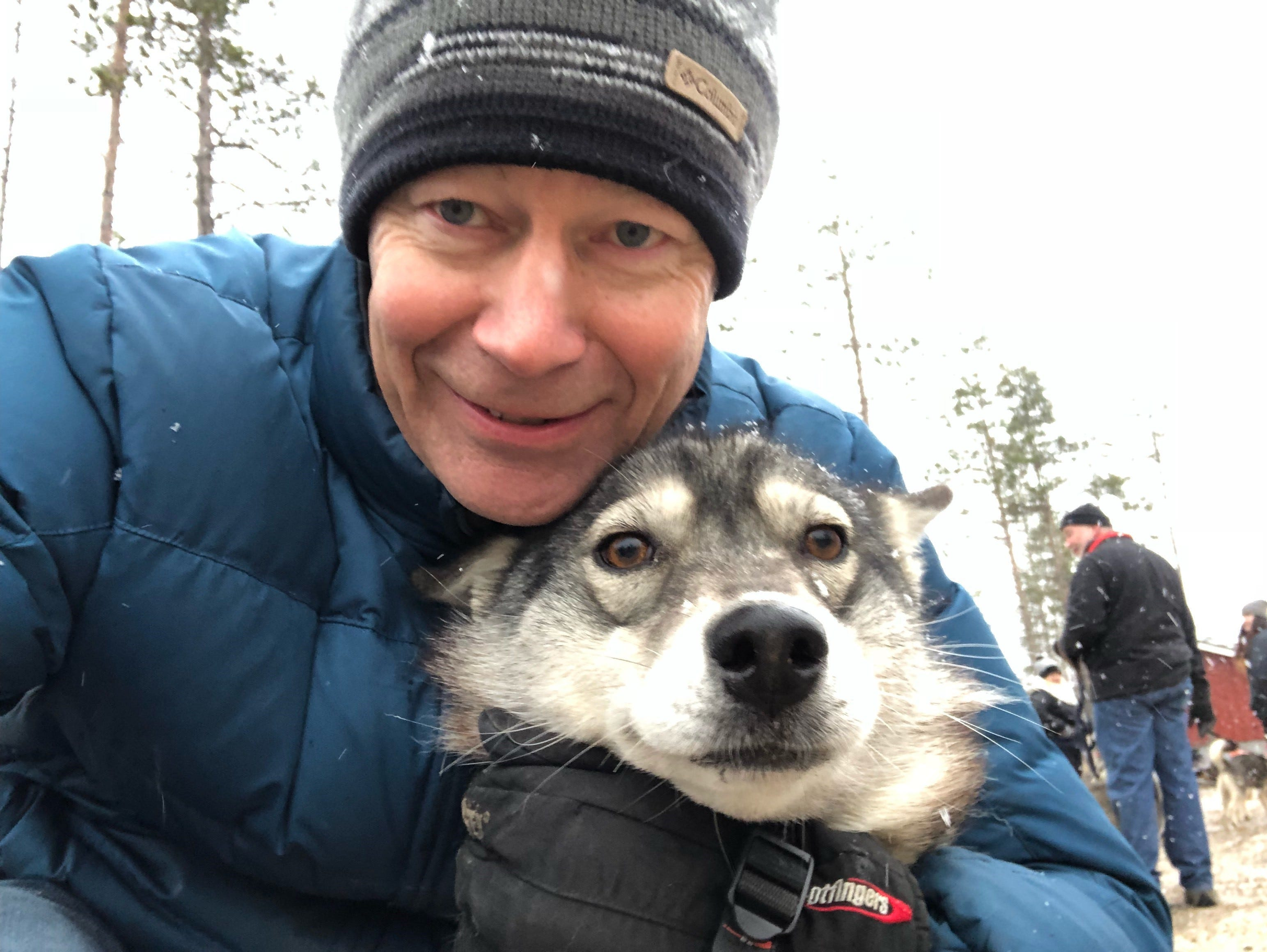 Yep, man's best friend. Ed McKenna snuggles with husky dog Zepo, his partner for some sledding fun in Finland.