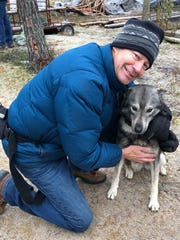 South Lyon's Ed McKenna bonds with Zepo, the husky sledding dog he was paired up with during his trip to Ivalo, Finland.