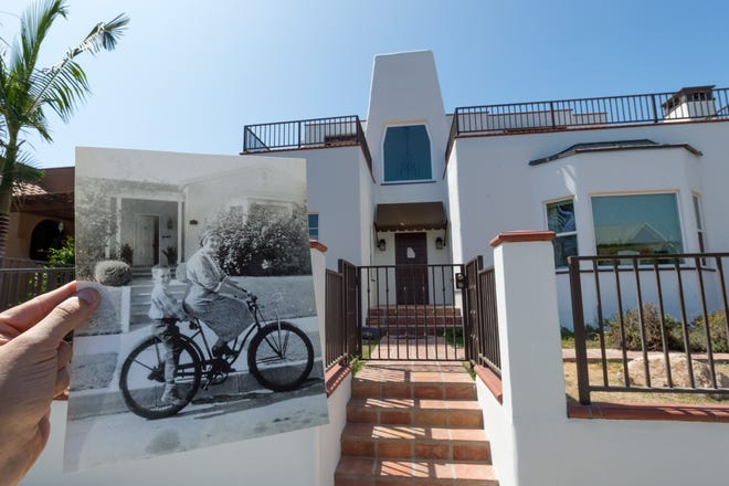 A photo of the one-story white colonial, from the 1950s, with original owner Rebecca Corcoran and her grandson Jay Mathews on the bicycle, is held in front of today's larger Spanish-style home.
