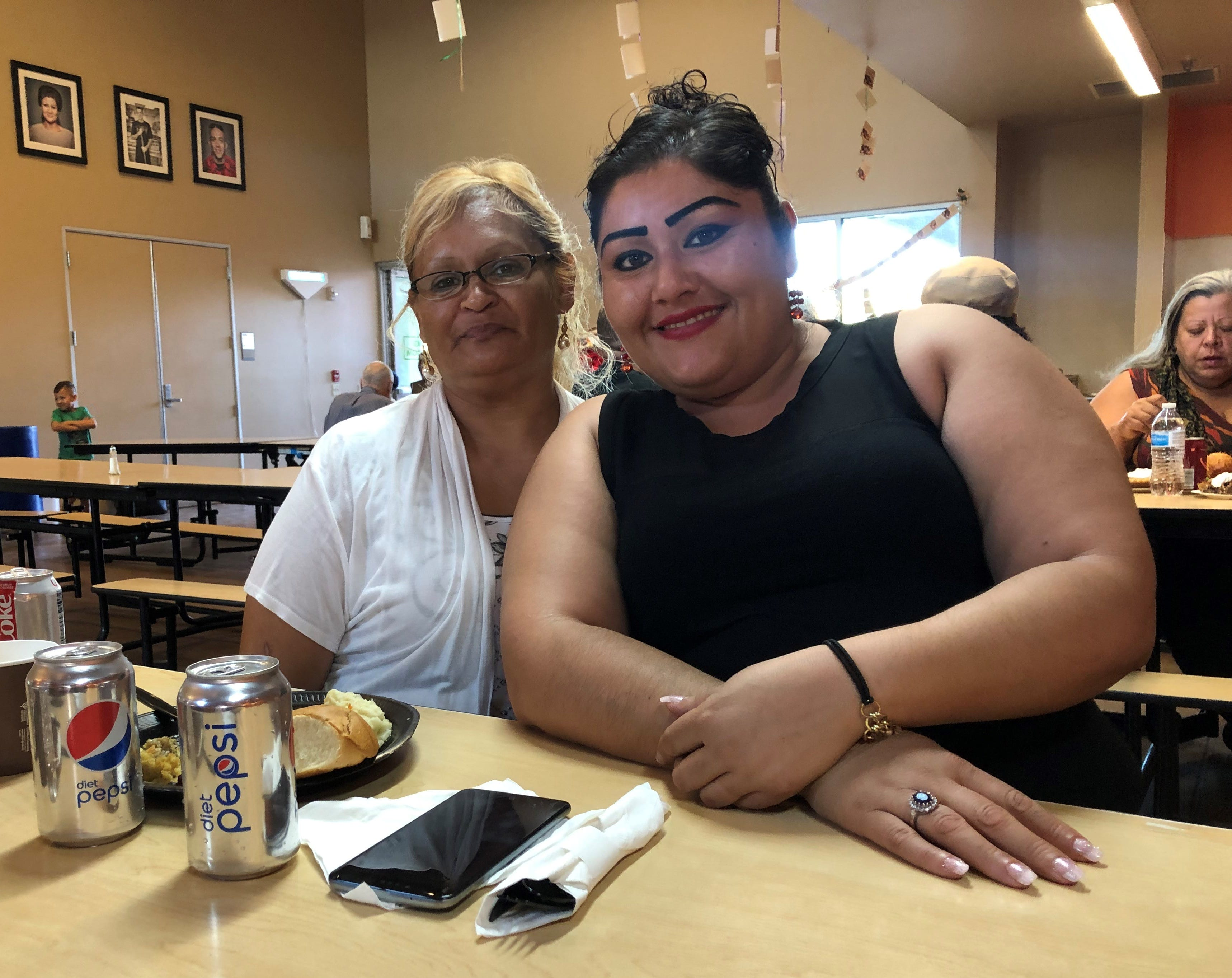 Leticia Torres, 49, and Maricela Anguiano, 31, are residents and friends at the Coachella Valley Rescue Mission in Indio. On Thursday, they celebrated Thanksgiving together at the mission. Ricardo Lopez/ The Desert Sun