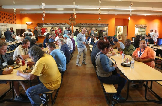 Thousands of people were expected to show up throughout the day for a Thanksgiving meal at the Coachella Valley Rescue Mission in Indio, November 22, 2018