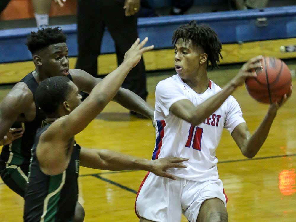 Pine Forest's Kobe Romain-Grant (10) tries to keep the ball away from the Pensacola Catholic defenders in the preseason basketball jamboree at Escambia High School on Tuesday, November 20, 2018.