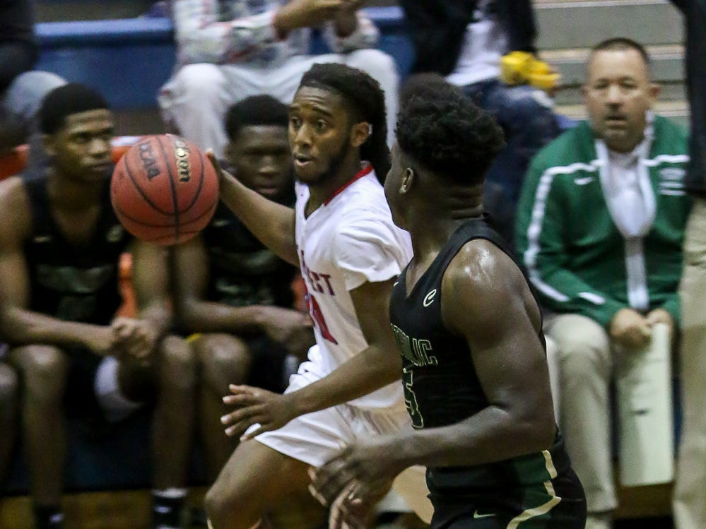 Pine Forest's Fred Lett (30) races up the court against Pensacola Catholic in the preseason basketball jamboree at Escambia High School on Tuesday, November 20, 2018.