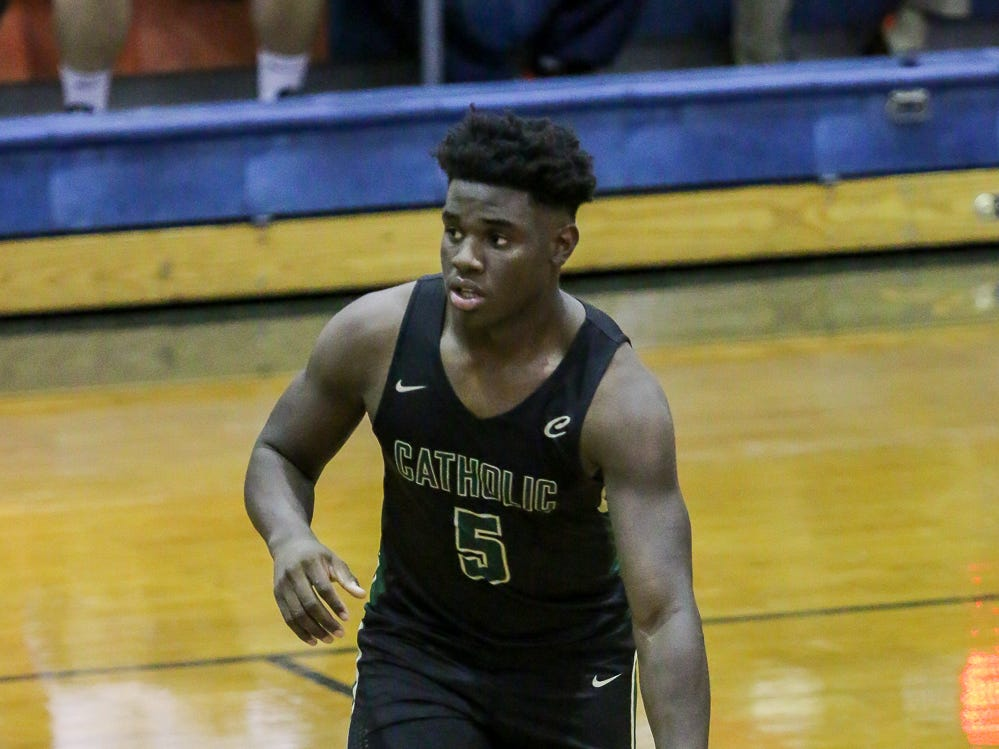 Pensacola Catholic's Jacobi Jackson (5) dribbles the ball against Pine Forest in the preseason basketball jamboree at Escambia High School on Tuesday, November 20, 2018.