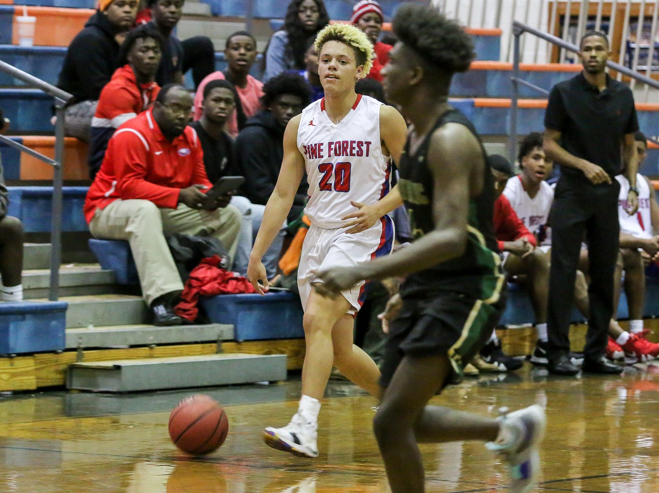 Pine Forest's Tyrese Powell (20) dribbles the ball up the court against Pensacola Catholic in the preseason basketball jamboree at Escambia High School on Tuesday, November 20, 2018.