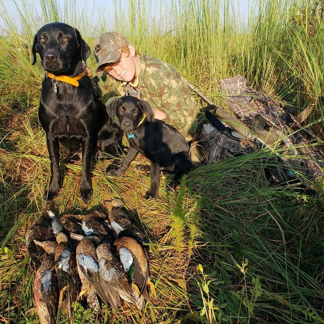 Cooper Lewis with some nice ducks he shot while hunting with his dad Kenny Lewis of Panhandle Charters and Guide Service.