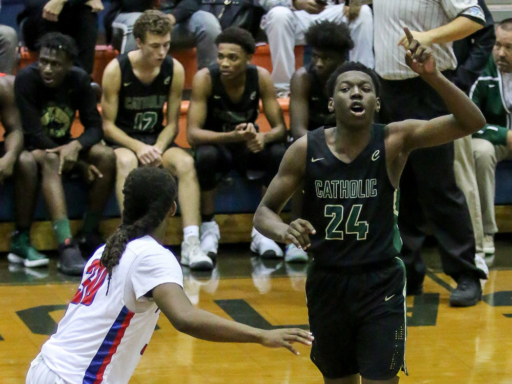 Pensacola Catholic's DJ McKenzie (24) calls out a play against Pine Forest in the preseason basketball jamboree at Escambia High School on Tuesday, November 20, 2018.