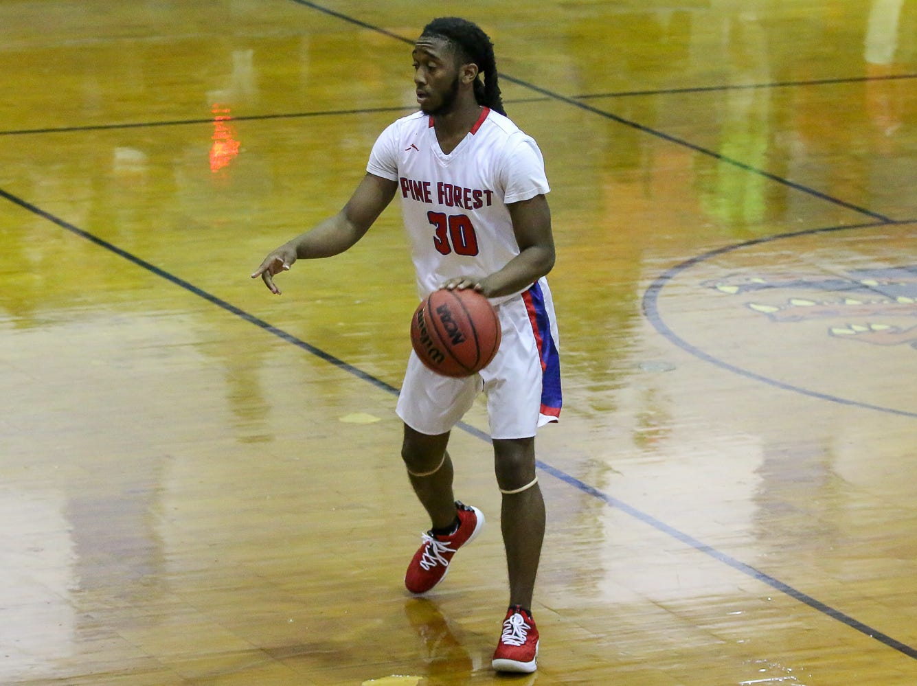 Pine Forest's Fred Lett (30) waits for his teammates to get into position against Pensacola Catholic in the preseason basketball jamboree at Escambia High School on Tuesday, November 20, 2018.