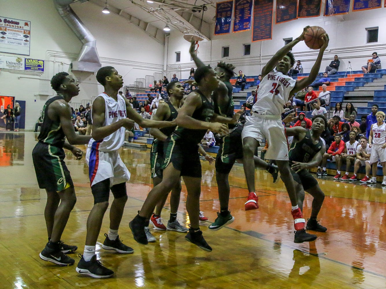 Pine Forest's Jalen Bryant (24) comes down with a rebound against Pensacola Catholic in the preseason basketball jamboree at Escambia High School on Tuesday, November 20, 2018.