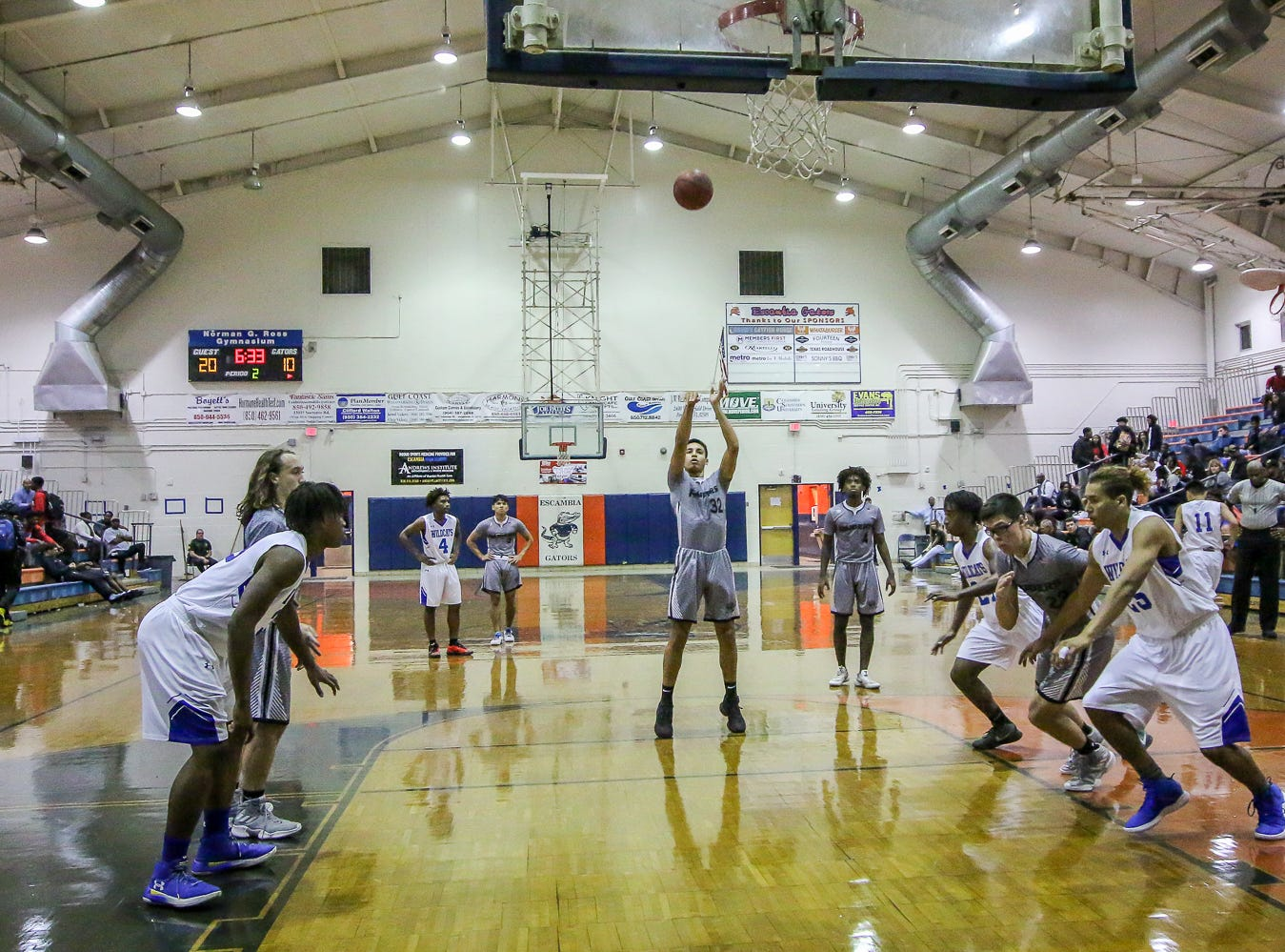 Navarre's David Melega (23) shoots a free throw against Washington in the preseason basketball jamboree at Escambia High School on Tuesday, November 20, 2018.