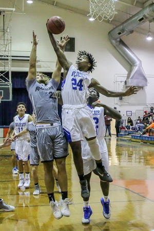 Washington's Iahn Figeroa (24) steals the rebound before Navarre's Corey Escbedo (20) can grab it in the preseason basketball jamboree at Escambia High School on Tuesday, November 20, 2018.