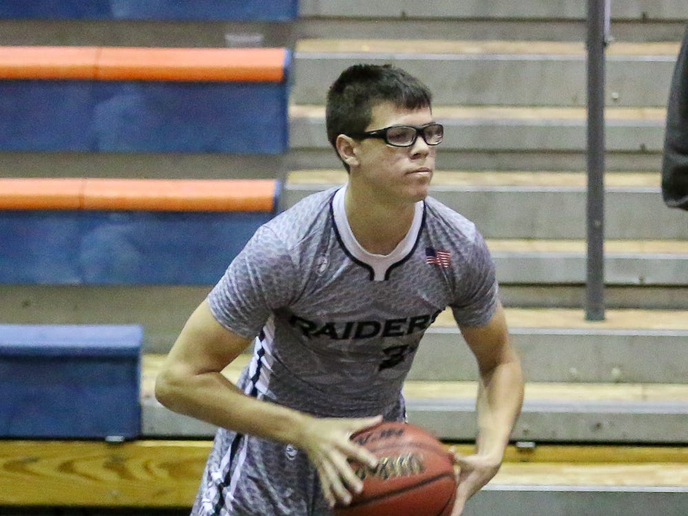 Navarre's Joseph Sczesny (23) looks for an open teammate to pass to against Washington in the preseason basketball jamboree at Escambia High School on Tuesday, November 20, 2018.