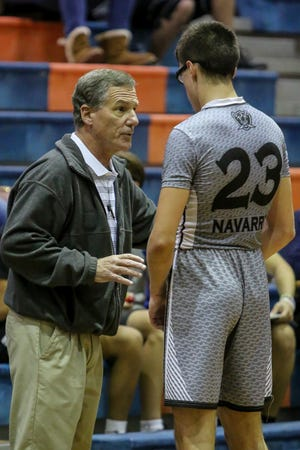 Navarre head coach Terry Posey talks with Joseph Sczesny (23) in between plays against Washington in the preseason basketball jamboree at Escambia High School on Tuesday, November 20, 2018. This is Posey's first year as the Raiders' head coach.