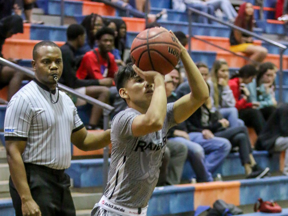 Navarre's Eric Pitino (5) shoots a three-point shot against Washington in the preseason basketball jamboree at Escambia High School on Tuesday, November 20, 2018.