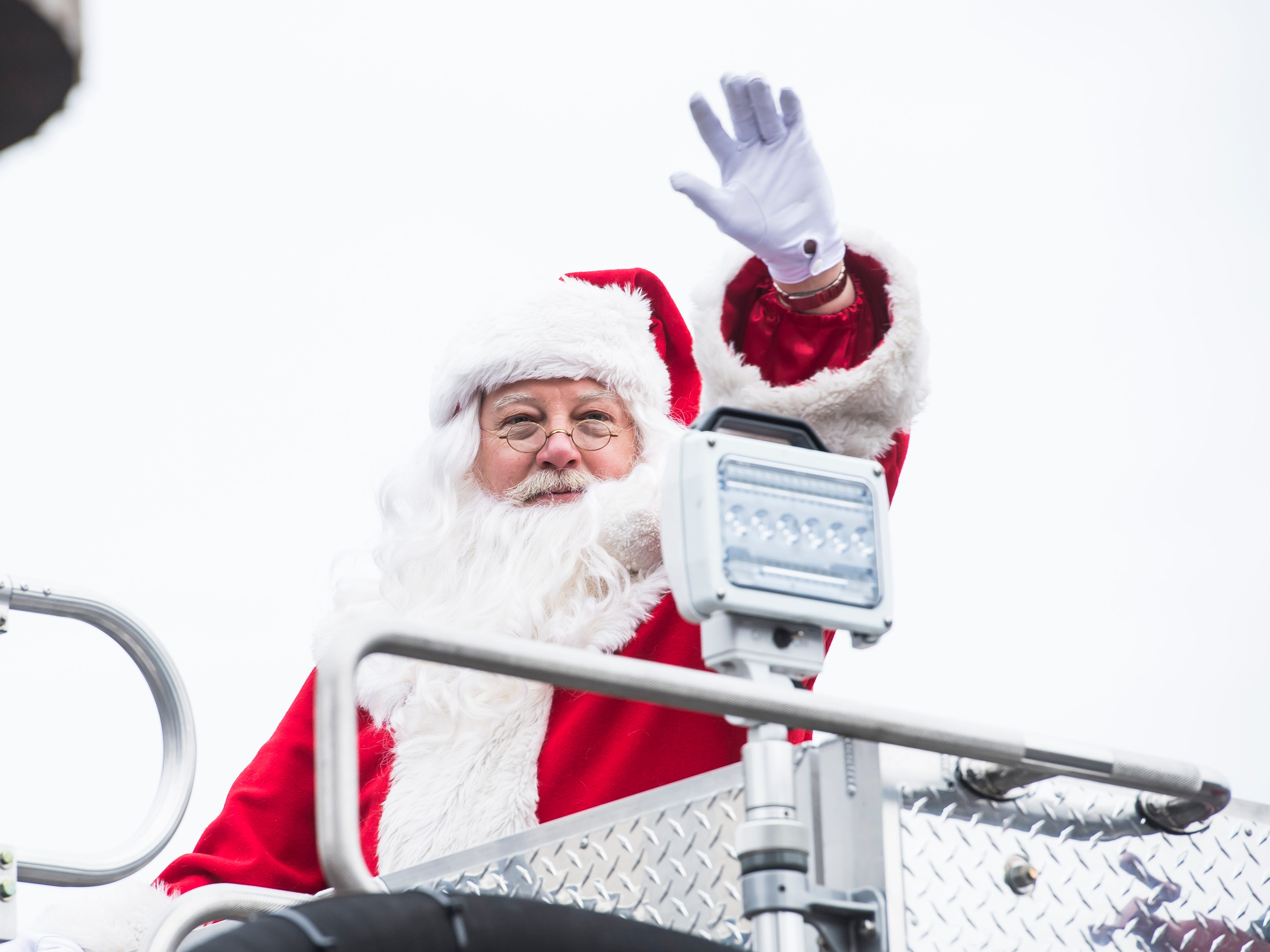 Santa waves to the crowd during the annual Hanover Christmas parade on Friday, November, 23, 2018.