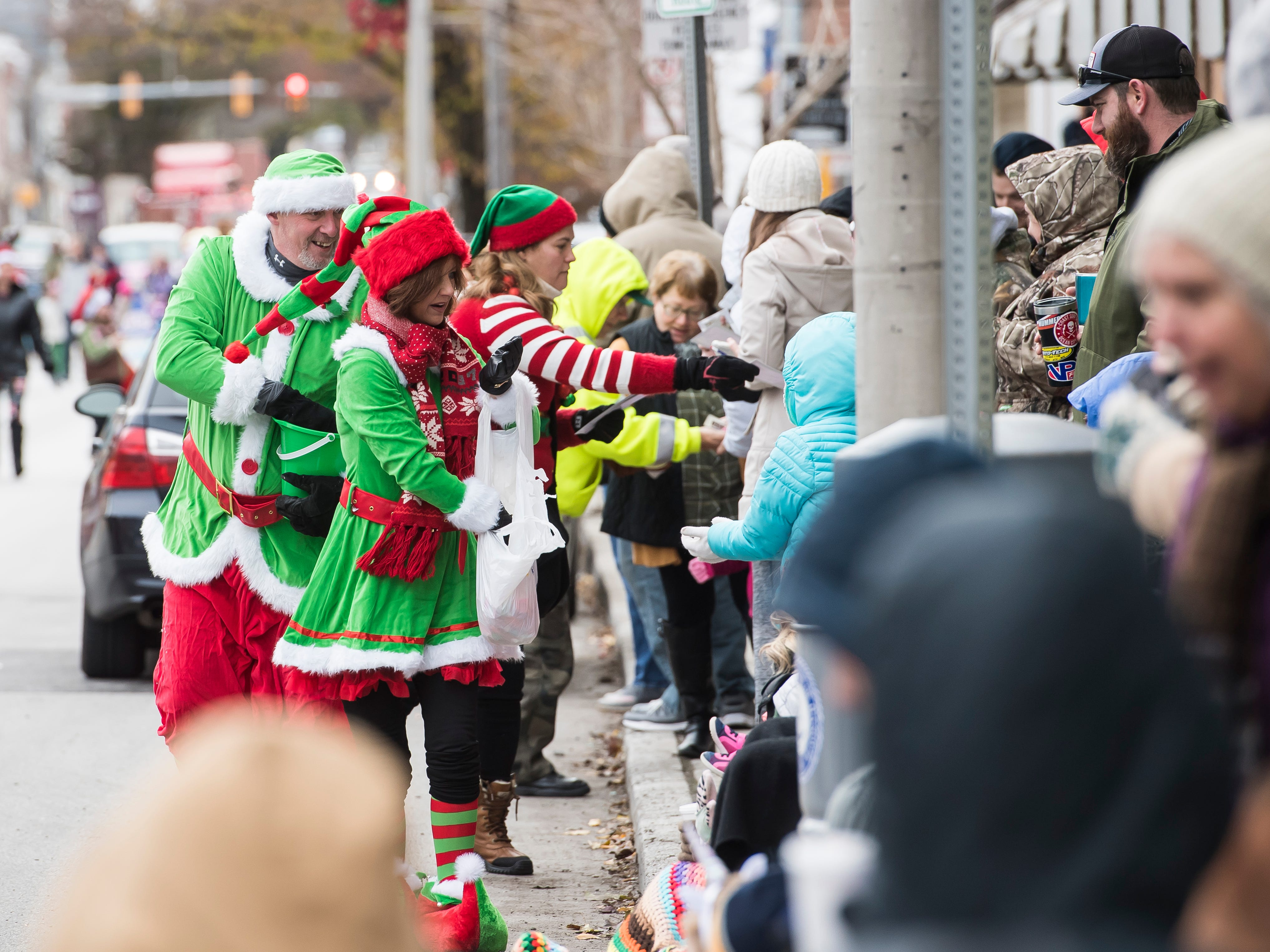 Santa's helpers pass out candy during the annual Hanover Christmas parade on Friday, November, 23, 2018.