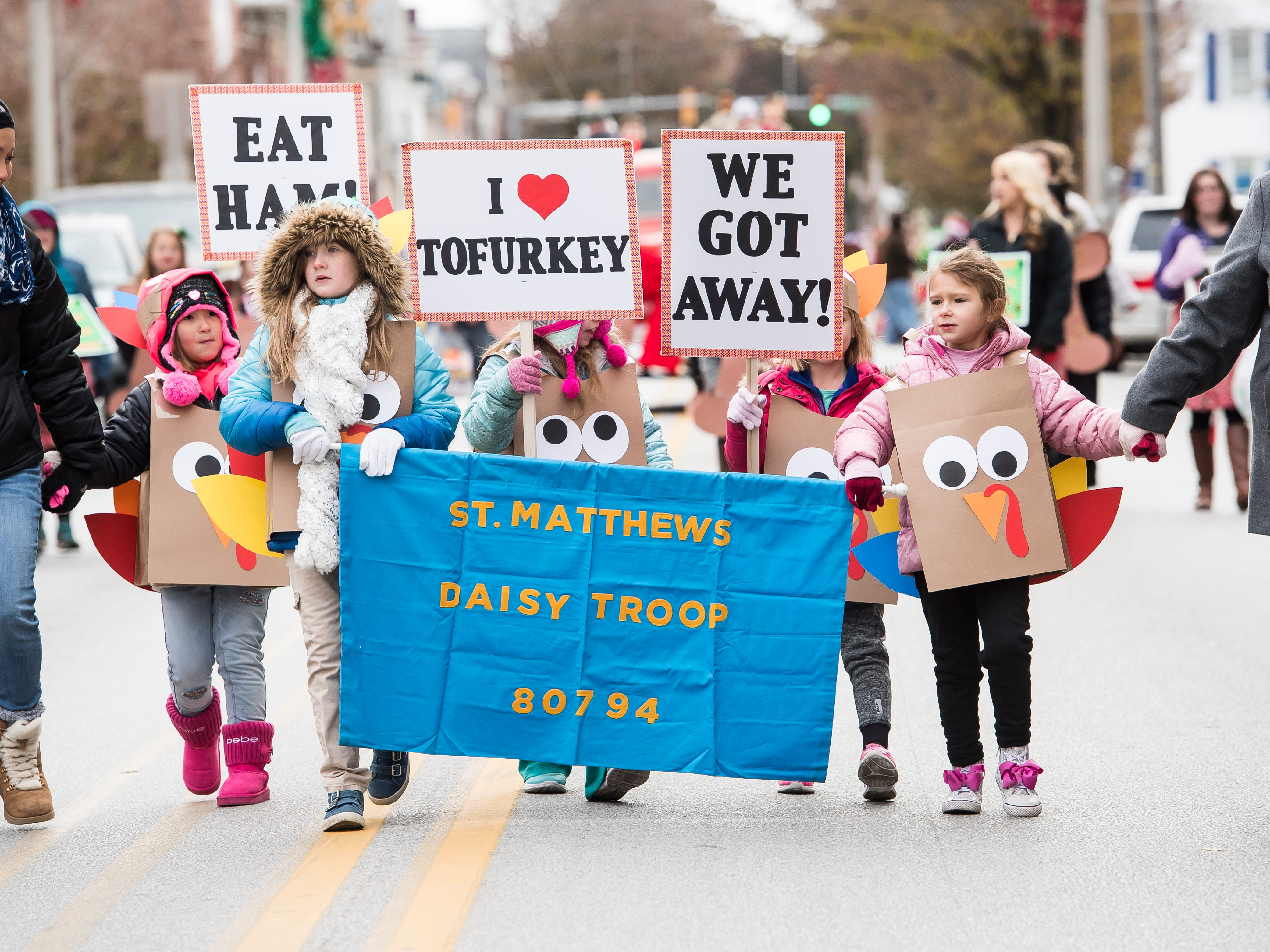 Girls Scouts in Daisy Troop 80794 march in the annual Hanover Christmas parade on Friday, November, 23, 2018.