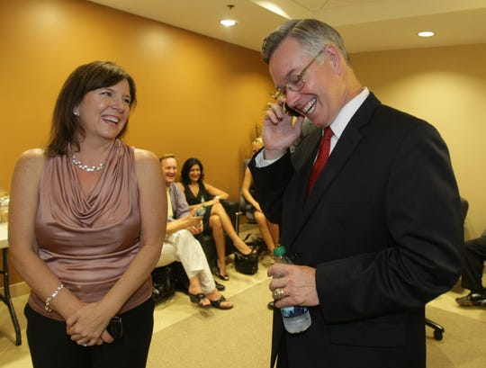 Bill Montgomery and his wife, Becky Montgomery, are all smiles after winning the Maricopa County Attorney race, in Phoenix in 2010.