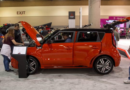People took advantage of the opportunity to look inside and out at vehicles at the auto show, like this 2019 Kia Soul.