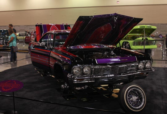 Cars like this 1965 Chevrolet Impala are on display at the Arizona International Auto Show.