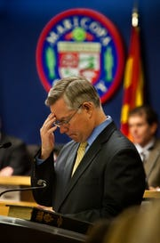Maricopa County Attorney-elect Bill Montgomery prays before delivering his address at his swearing-in ceremony at the Board of Supervisors' downtown Phoenix auditorium on Nov. 22, 2010.