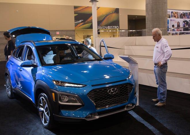 Visitors at the Arizona International Auto Show looked at the 2019 Hyundai Kona.