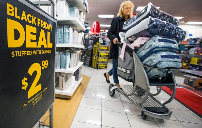 Monica Cavalliere of Scottsdale stocks up on comforters as she shops for Black Friday specials at the Kohl's store at Desert Ridge Marketplace in Phoenix early on Nov. 23, 2018.  Thousands of shoppers around the Valley sought out great deals on everything from electronics and clothing to household items and toys.