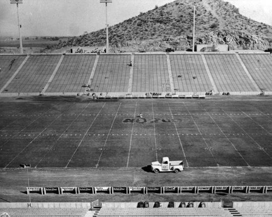 "A photo of Sun Devil Stadium's field on its opening day in 1958. Officials suspected that students from rival University of Arizona burned ""No 200"" on the 50-yard line. Proposition 200, which was on the ballot that year, was a measure to change the name of the college to Arizona State University. Credit: Arizona State University Archives"