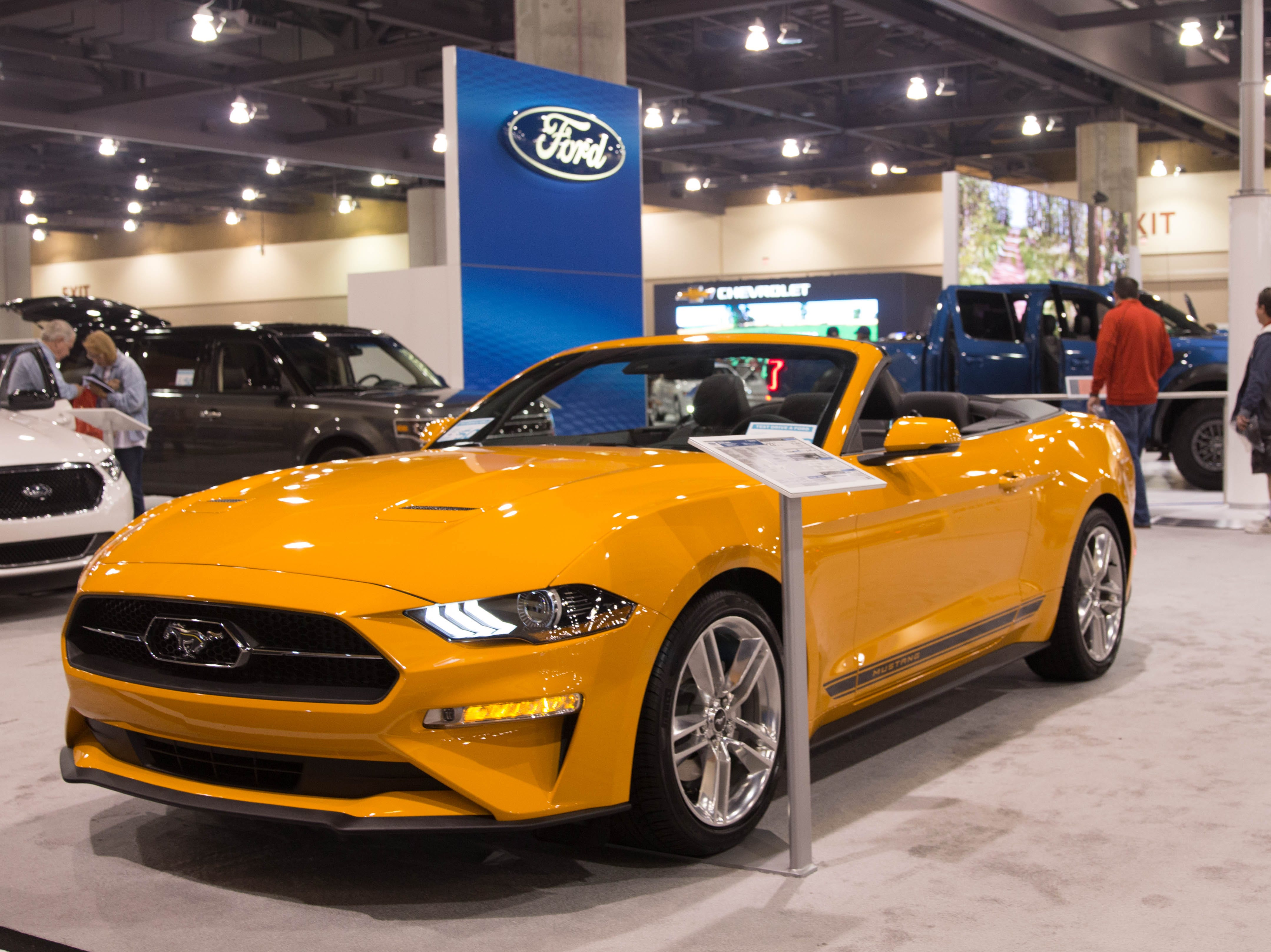Vehicles like the 2019 Ford Mustang were available for visitors to check out at the auto show.