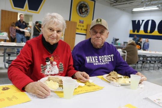 Betty and Jon Brown, of Elmore, enjoy their meal at the Community Thanksgiving Dinner at Woodmore High School on Thursday.