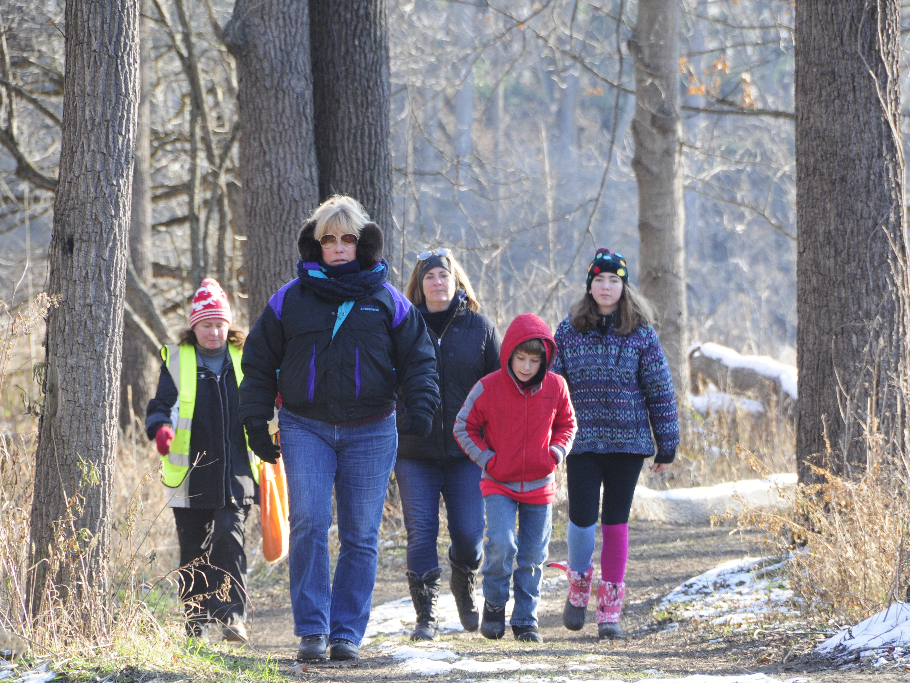 From left, Kirsten Lyons, Deb Mathes, Jennifer Jozwiak, Jake Jozwiak and Jaelyn Jozwiak walk during  Friday's Opt Outside hike at Columbus County Park.