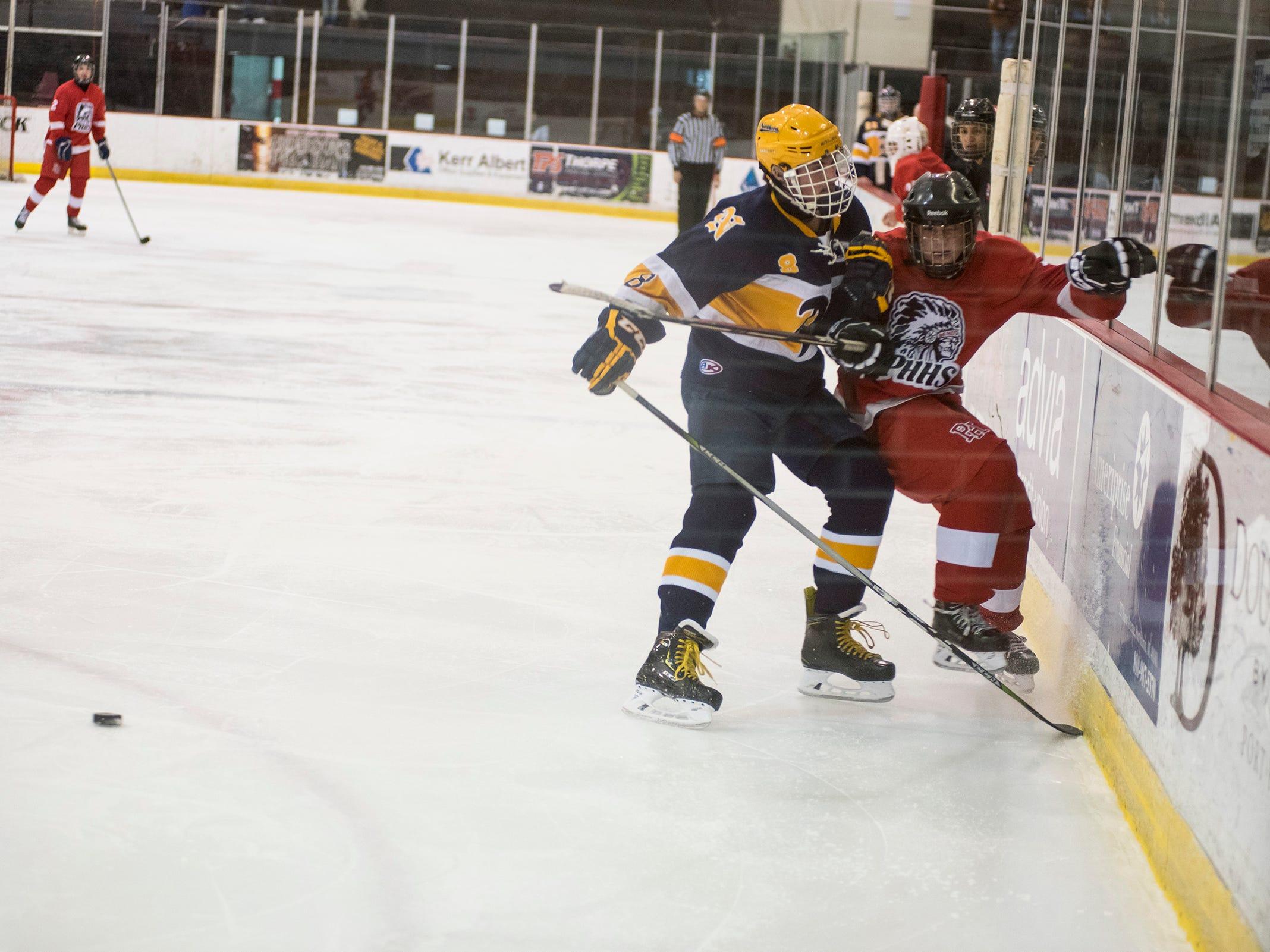 Port Huron Northern High School defense Owen Lawson (8) runs into Port Huron High School forward Matthew Fleming during the Larry Manz Holiday Hockey Tournament Friday, Nov. 23, 2018 at McMorran Arena.