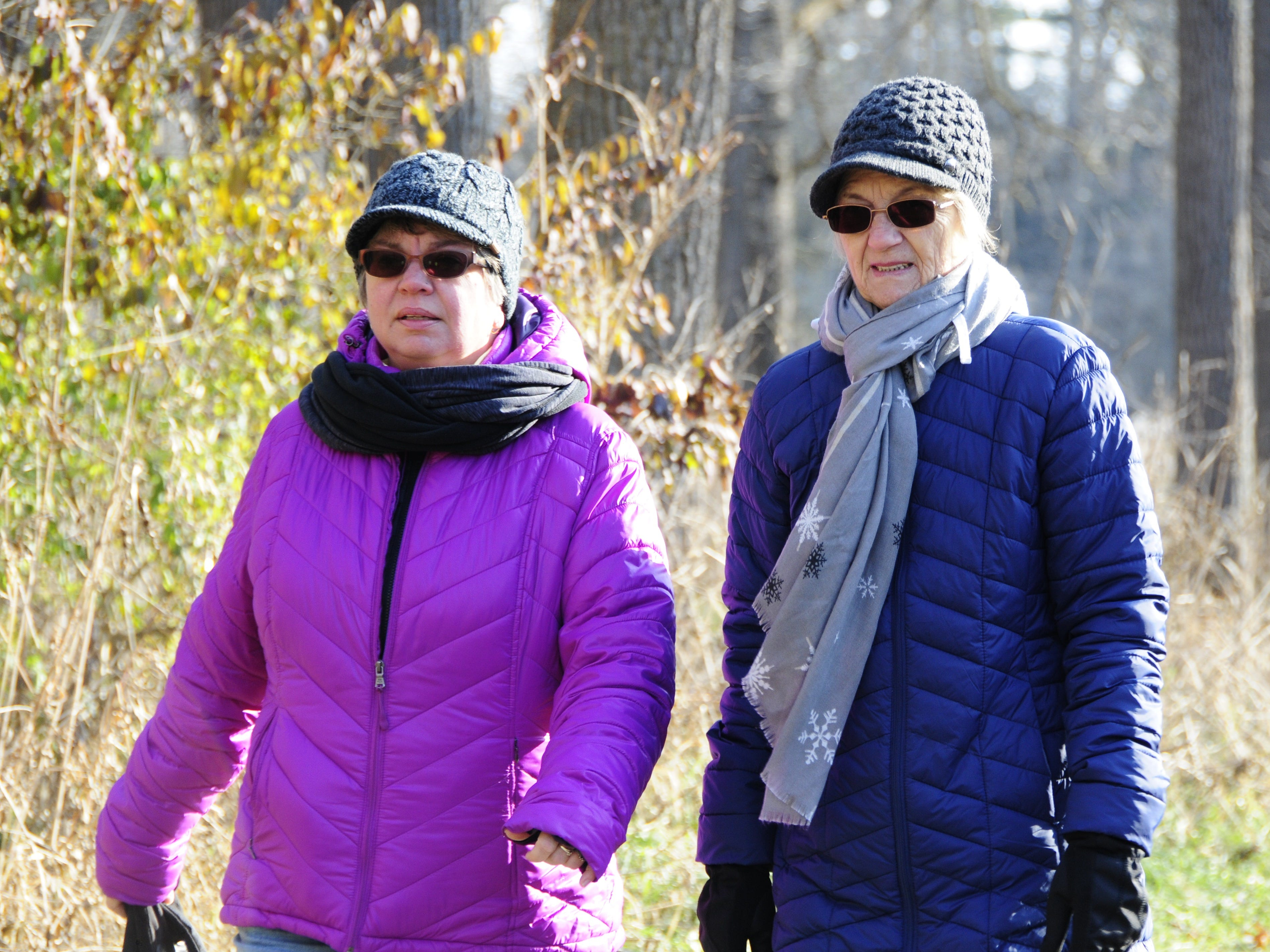 Karen Finch, left, and Carol Weischler walk during  Friday's Opt Outside hike at Columbus County Park.