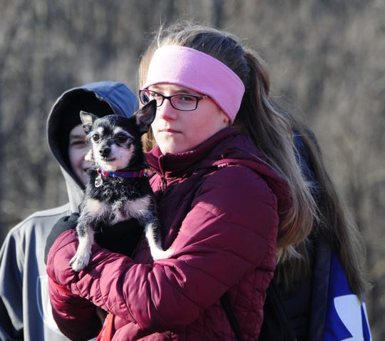 Julia Houle holds Amigo at Friday's Opt Outside hike at Columbus County Park.