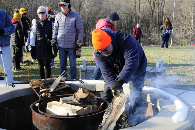 St. Clair County Parks and Recreation employee Billy Piper lights a fire  at Friday's Opt Outside hike at Columbus County Park.