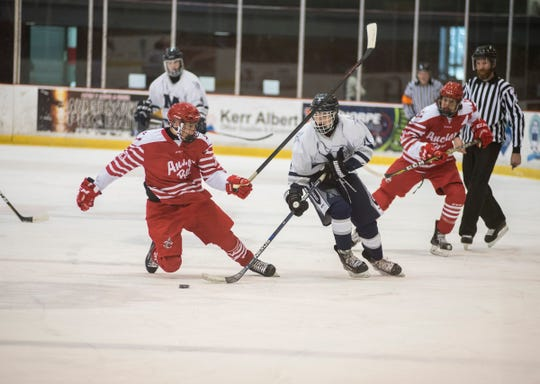 Anchor Bay High School defensive James Skorupski (left) chases the puck against Marysville High School forward Ty VanHouteghen during the Larry Manz Holiday Hockey Tournament Friday, Nov. 23, 2018 at McMorran Arena.