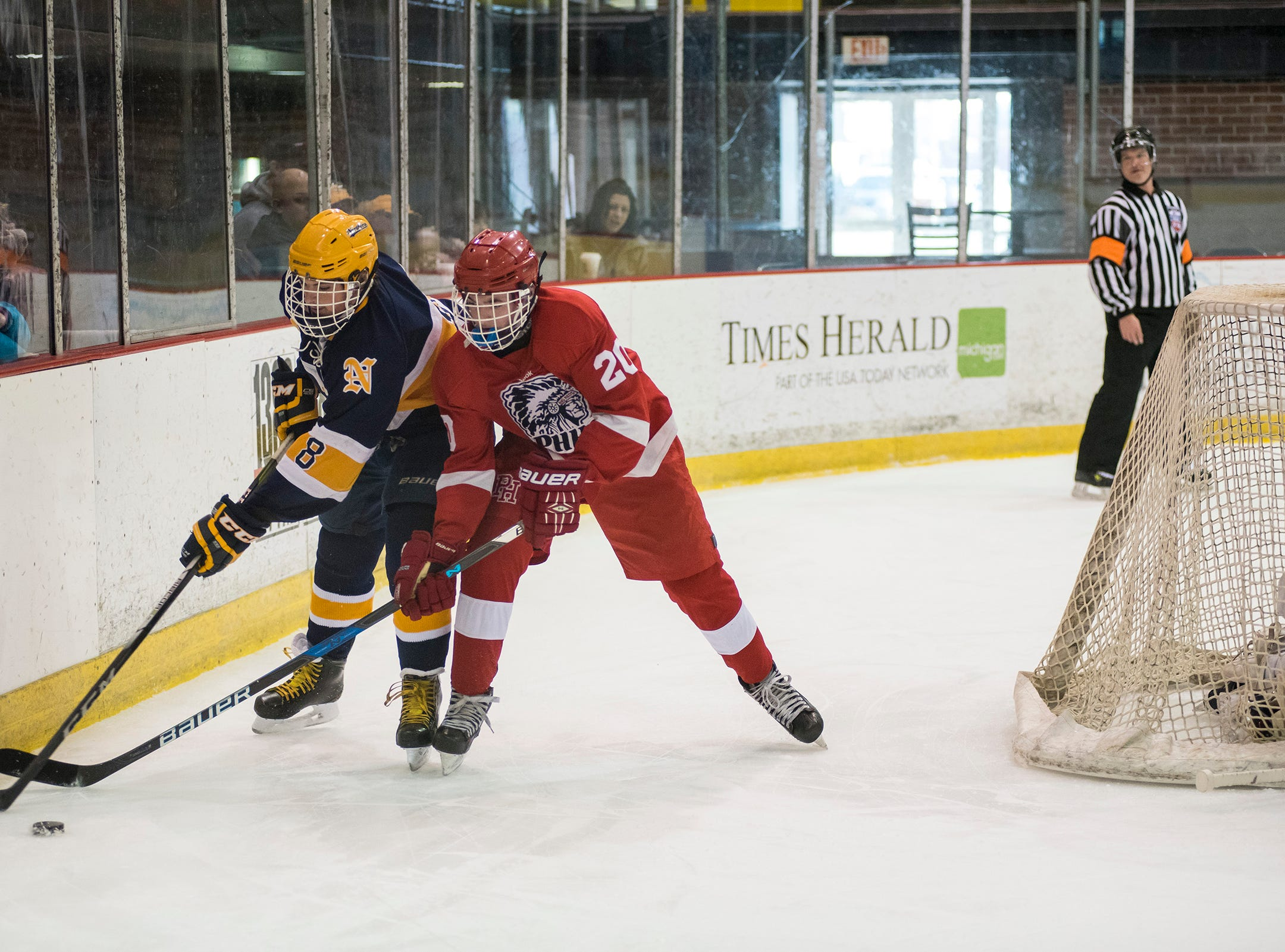 Port Huron Northern High School defense Owen Lawson (8) steals the puck from Port Huron High School defense Kevin Schott during the Larry Manz Holiday Hockey Tournament Friday, Nov. 23, 2018 at McMorran Arena.