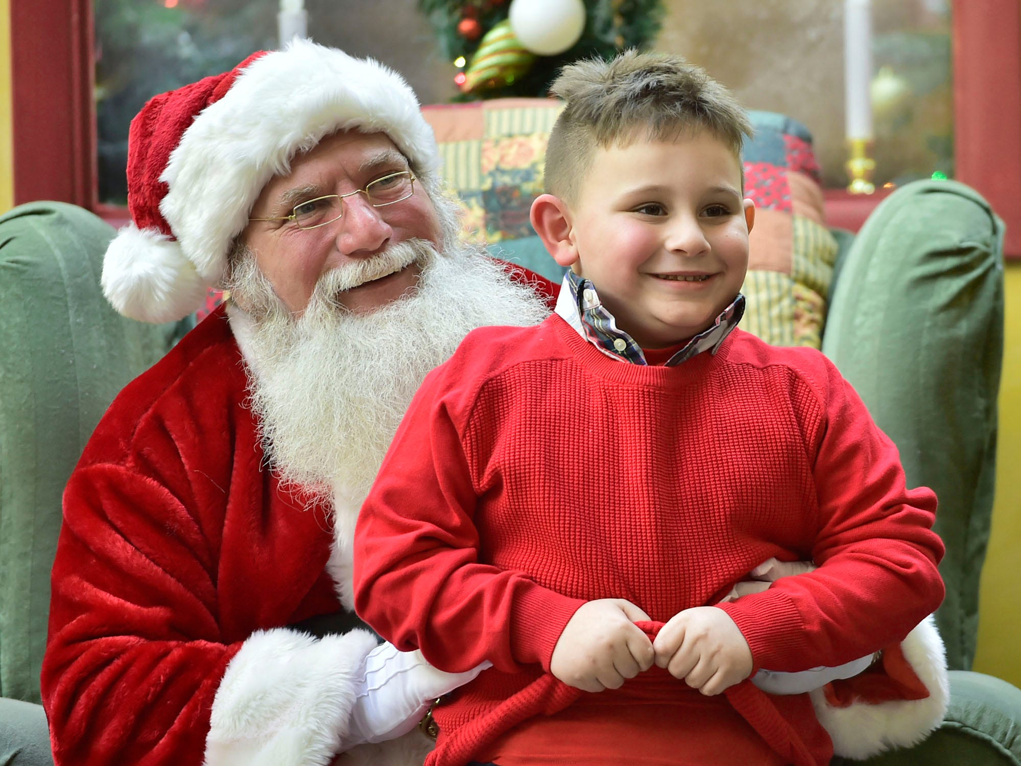 Santa poses with Noah Robinson, McConnellsburg, at Chambersburg Mall. Shoppers were at local malls and stores to search for Black Friday deals, November 23, 2018.
