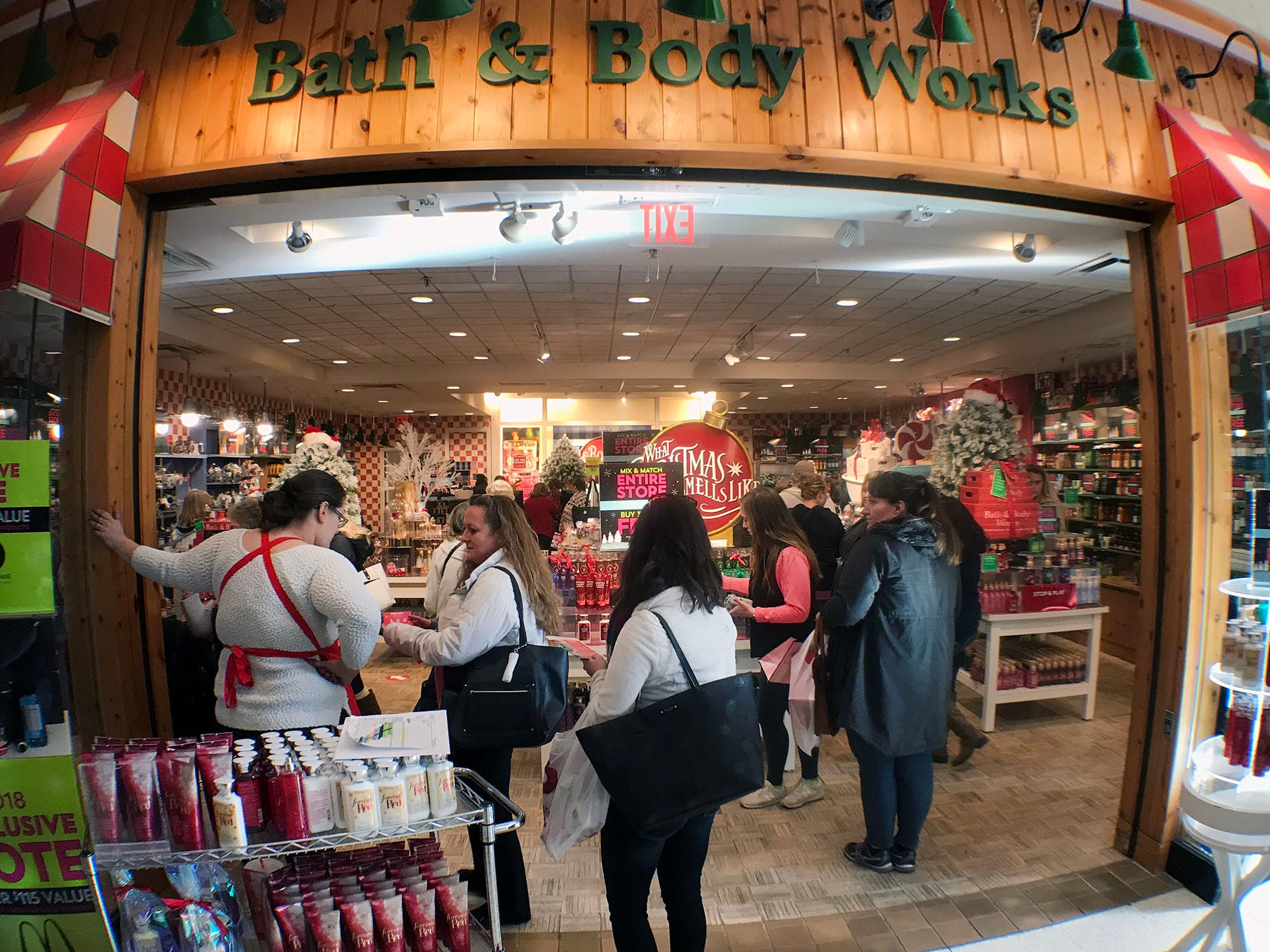Shoppers look for gifts at Bath & Body Works at Chambersburg Mall. Shoppers were at local malls and stores to search for Black Friday deals, November 23, 2018.