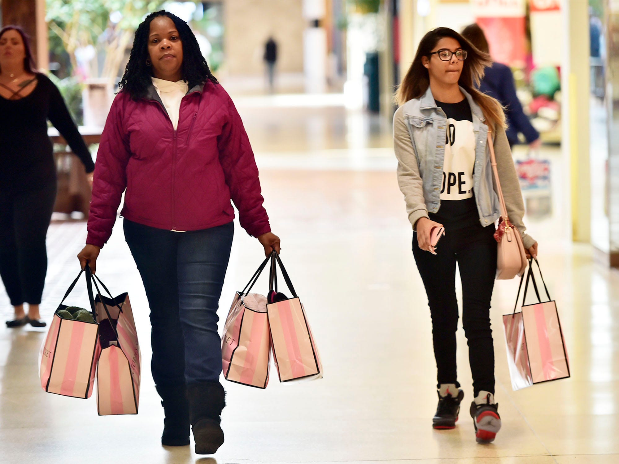 Valarie Johnson, left, shops with her niece, Katora Walker, at Chambersburg Mall on Friday, November 23, 2018. Shoppers were at the malls and stores looking for great deals on Black Friday.