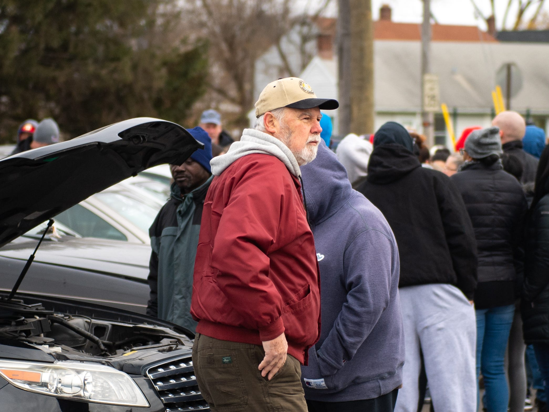 Bidders spend out around the lot meticulously looking at each car and getting a price in mind, November 23, 2018.