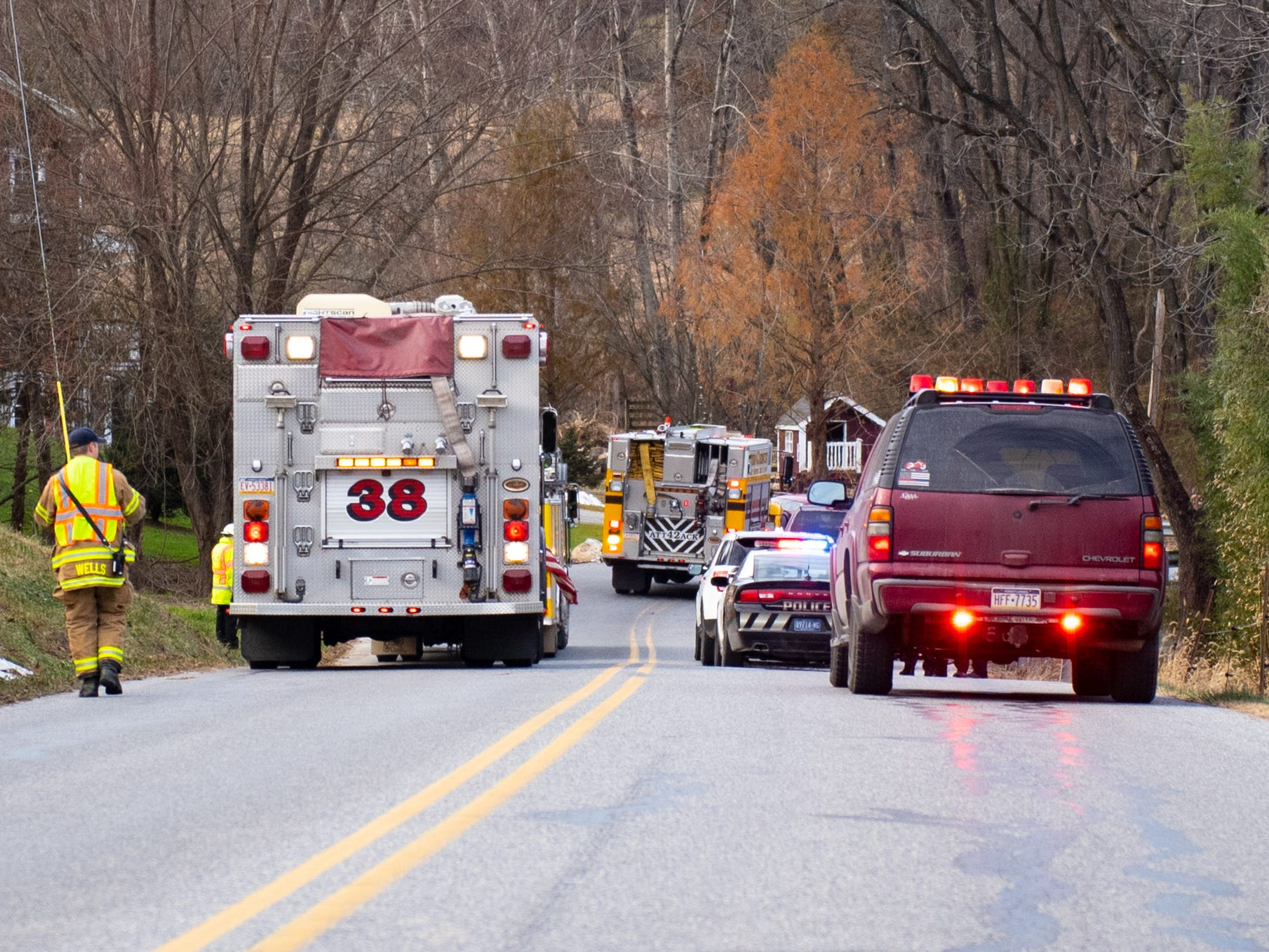 Emergency vehicles line Cabin Creek Road as crash victims are helped from their cars, November 23, 2018.