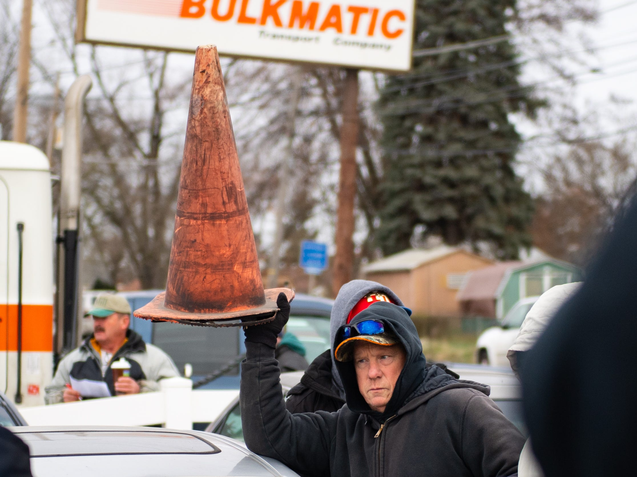 An orange cone is held over cars being bid on at the moment during the York County Drug Task Force auction on Black Friday, November 23, 2018.