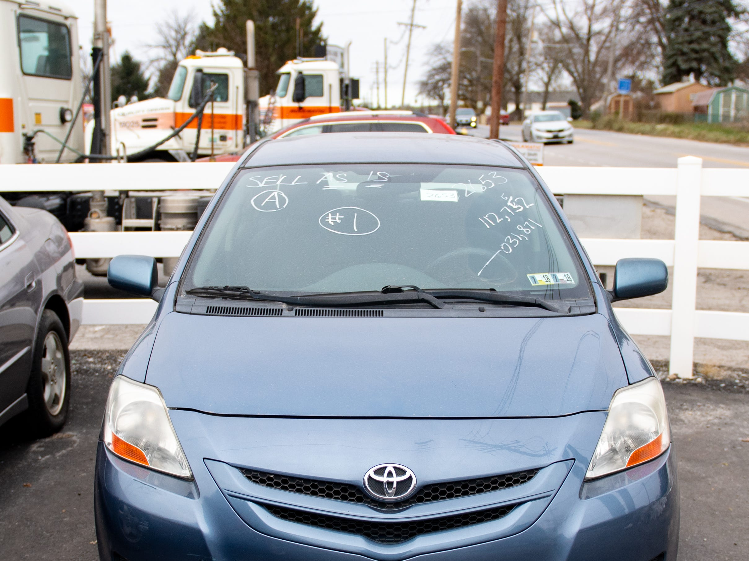 Information about each car is written on their respective windshields during the York County Drug Task Force auction on Black Friday, November 23, 2018.