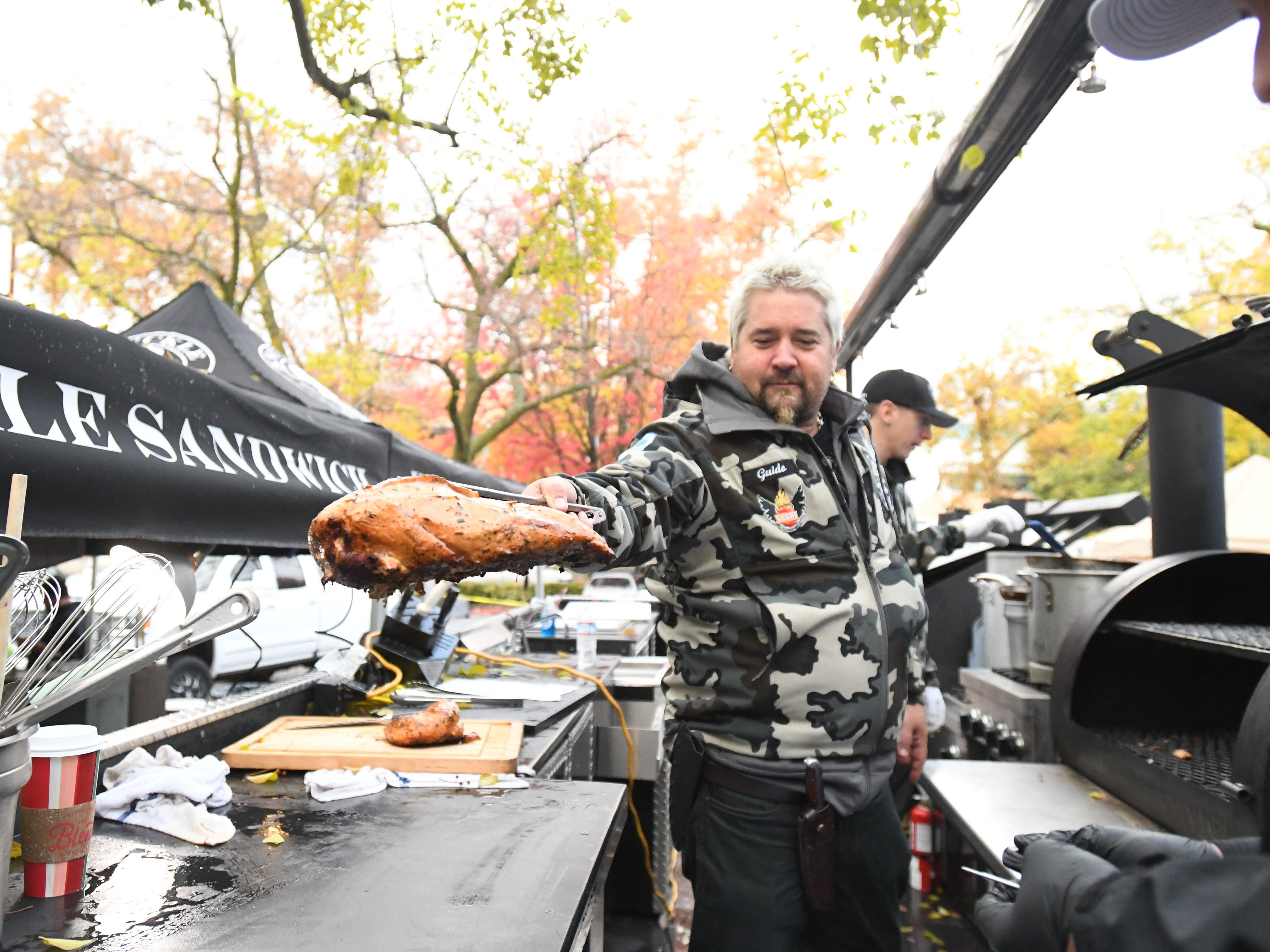 Chef Guy Fieri is among the hundreds of volunteers in downtown Chico, Calif., preparing Thanksgiving dinner on the morning of Nov. 22, 2018 for  evacuees of the Camp Fire in Northern California.