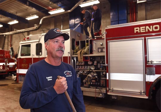 Fire captain Joe Dolan stands at fire station10 while he and his crew wash the fire truck after arriving from the California fires. Dolan was on the team from Reno searching for bodie in the Camp Fire.