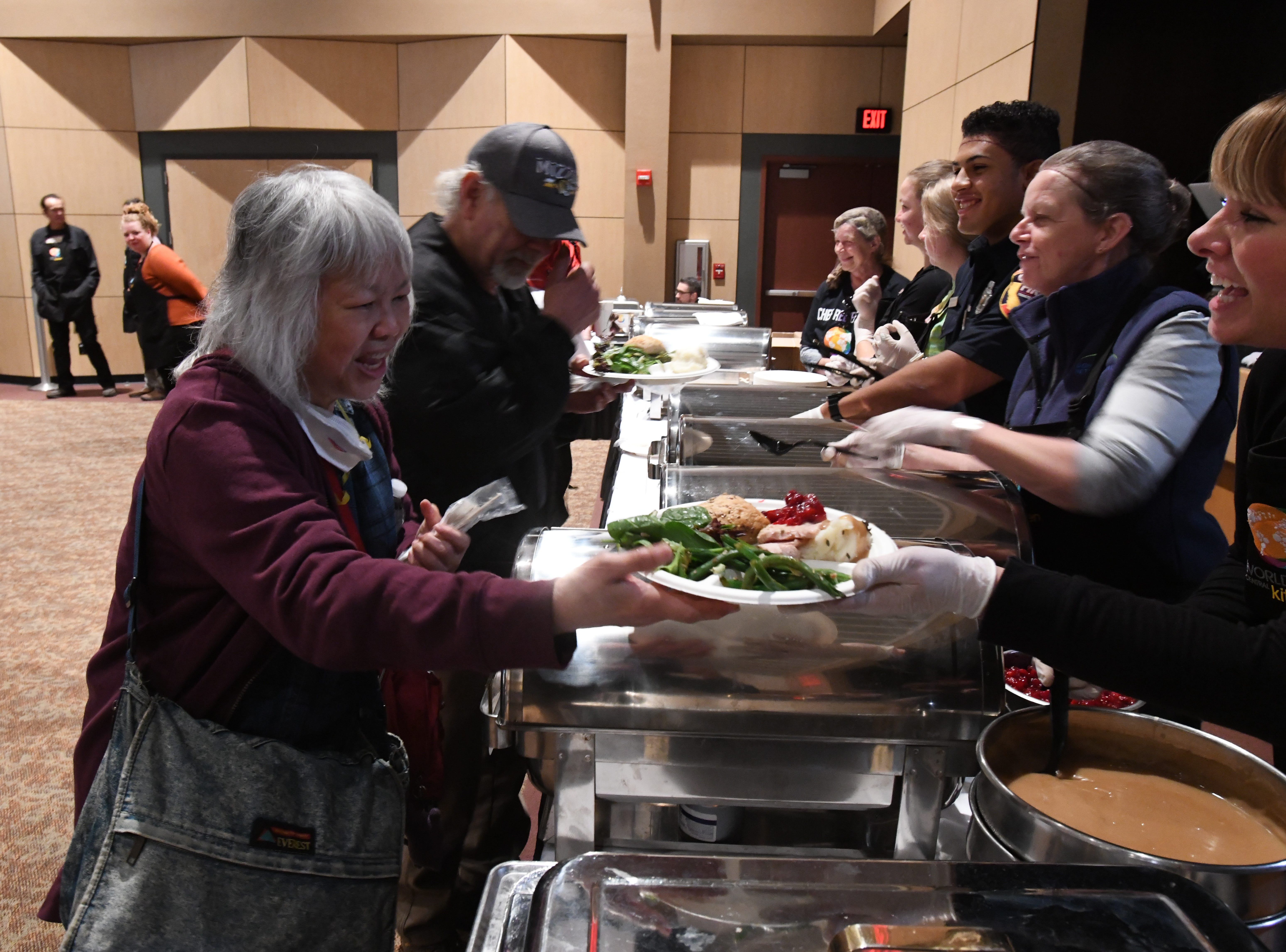 Colleen Love of Paradise, Calif., gets a Thanksgiving meal along with other evacuees from the Camp Fire on Nov. 22, 2018 in Chico, Calif. Love is among thousands of people who lost homes in the fire.