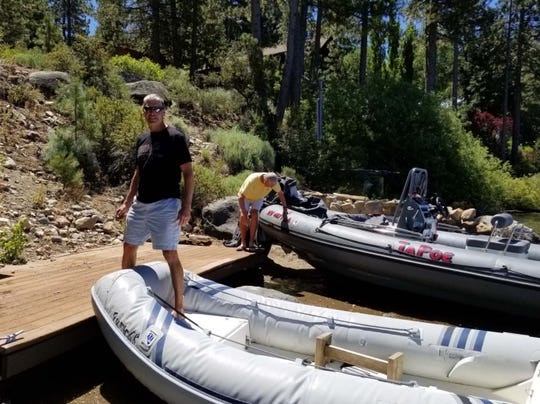 Jay Poe standing on the deck of his Lake Tahoe property on July 12, 2017 when the water level was less than an inch below the high water mark.