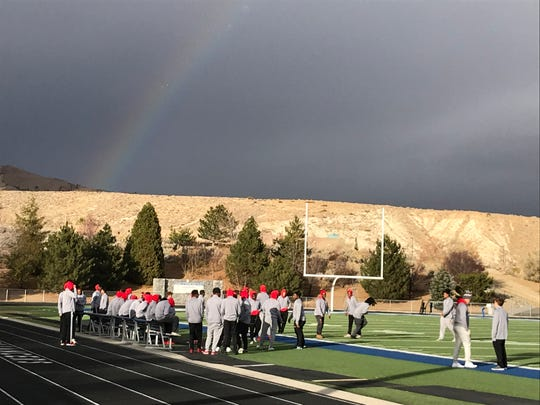 The Arbor View football team gets a look at the McQueen football field Friday afternoon.
