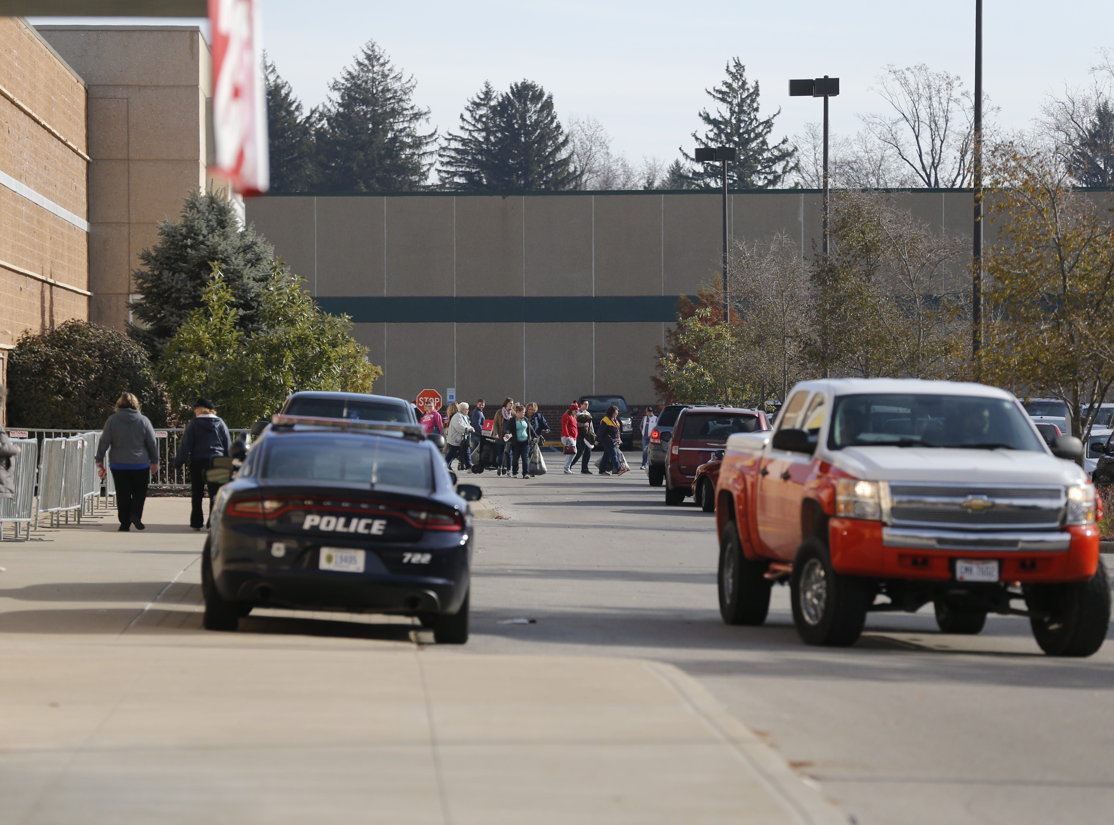 A stream of shoppers pours from the Richmond Kohl's store after taking advantage of Black Friday deals on Nov. 23, 2018.